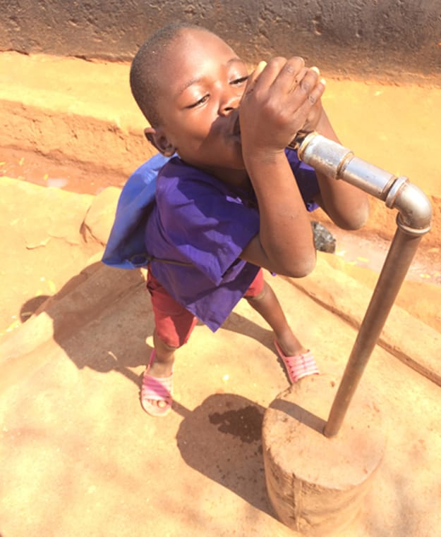 Image of malawi boy drinking clean water - cooleraid lifeline fund